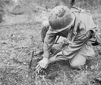 S-mine - An American infantryman probes for mines using a knife.
