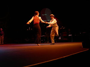 Dance in the United States - Mia Goldsmith and Peter Loggins swing dancing at the 100th anniversary of the Moore Theatre (Seattle, Washington), 2007.