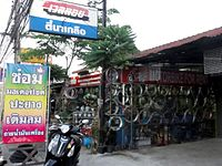 Motorcycle repair shop in Thailand.jpg