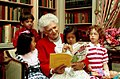 Mrs. Barbara Bush reads to children in the White House Library.jpg