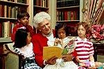 Mrs. Barbara Bush reads to children in the White House Library.jpg