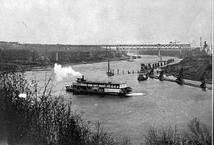 North Saskatchewan River - The North Saskatchewan in Edmonton circa 1913. Note steamboats in the foreground, construction of the High Level Bridge in the background, and mid-river piers for future Walterdale Bridge between.