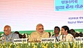 "Narendra Modi at the launch of the three Social Security Schemes, ""Pradhan Mantri Jeeven Jyoti Bima Yojana"", Pradhan Mantri Suraksha Bima Yojana"", and ""Atal Pension Yojana"", at Nazrul Manch.jpg"
