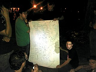 Timeline of Occupy Wall Street - September 3, 2011: A planning session for Occupy Wall Street is held at night in Tompkins Square Park