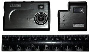 Oregon Scientific -  Credit card-sized digital camera, with external flash unit