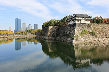 Inui-yagura Turret, guarding the outer moat of Osaka Castle and the skyline of Osaka Business Park