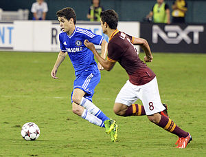 Érik Lamela - Lamela (r.) playing for Roma against Chelsea in August 2013