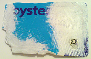 Oyster card - A modified card, revealing the microchip in the lower right corner and the aerial running around the edge of the card.