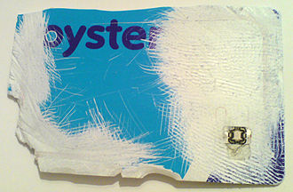 Oyster card - A damaged Oyster card, revealing the microchip in the lower right corner and the aerial running around the perimeter of the card.