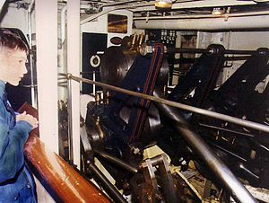 PS Waverley - Passengers passing the engine room see the huge piston rods driving the cranks on the shaft that turns the paddle wheels on each side. The supports here painted black are now painted green.