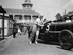 Paddy Naismith pushing her car onto the Brooklands track on 5 June 1933.jpg