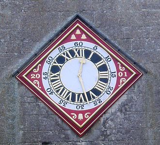 Painswick - The restored clock-face on the tower of St.Mary's
