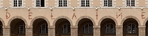 Saint George Palace - Detail of iron bar letters above arches