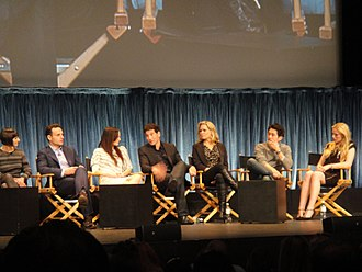 The Walking Dead (season 2) - The cast and crew of The Walking Dead at PaleyFest in 2011 (left to right): executive producer Gale Anne Hurd, Andrew Lincoln (Rick Grimes), Sarah Wayne Callies (Lori Grimes), Jon Bernthal (Shane Walsh), Laurie Holden (Andrea), Steven Yeun (Glenn Rhee), and Emma Bell (Amy)