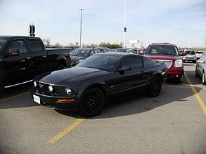 Double parking - A Ford Mustang occupying two spaces at Vaughan Mills mall, Ontario.
