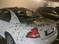 Perth hailstorm 2010 damaged car.jpg