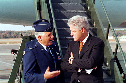 Col. Paul Fletcher, USAF and Clinton speak before boarding Air Force One, November 4, 1999. President Clinton talks with Col. Paul Fletcher, USAF.jpeg