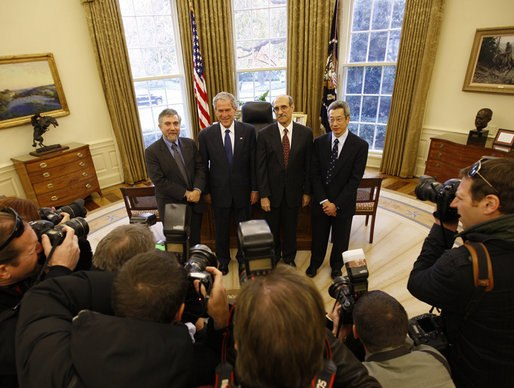 President George W. Bush poses for a photo with Nobel Prize winners Monday, Nov. 24, 2008