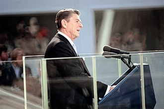 Black lounge suit - Former U.S. President Ronald Reagan in a stroller at his first presidential inauguration in 1981