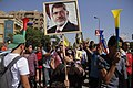 Protesters holding up poster of ousted President Morsi Nasr City-Cairo 11-Oct-2013.jpg