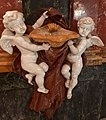 Putti on the holy water font at the Church of St Augustine, Valletta, June 2018.jpg