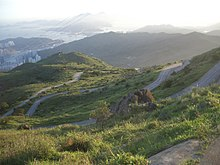 R38943437917 Upper section of Tai Mo Shan Road meandering up the mountain.JPG