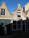 foto van Huis met geverfde klokgevel begin