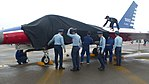 ROCAF Crew and Sergeants Covering Head of AIDC F-CK-1A 10003 in Rain 20161126a.jpg