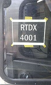 A temporary window sign with RTDX markings RTDX 4001 reporting mark sign seen from RTDX 4004 cab.jpg
