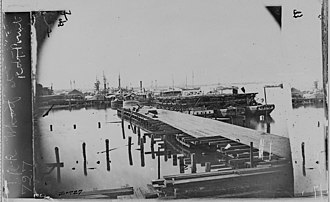 Southside Railroad (Virginia) - Railroad Wharf at City Point, Va. 28 railroad flat cars lined up on barges.