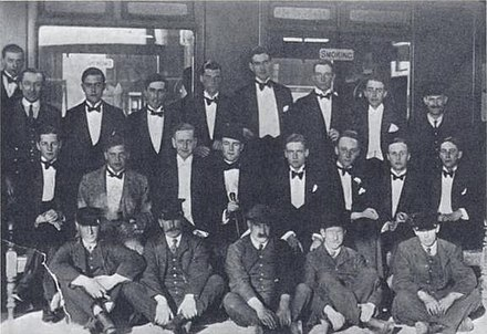Railway Club at Oxford, conceived by John Sutro, dominated by Harold Acton. Left to right, back: Henry Yorke, Roy Harrod, Henry Weymouth, David Plunket Greene, Harry Stavordale, Brian Howard. Middle row: Michael Rosse, John Sutro, Hugh Lygon, Harold Acton, Bryan Guinness, Patrick Balfour, Mark Ogilvie-Grant, Johnny Drury-Lowe; front: porters.