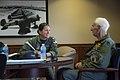 "Retired Cmdr. Dean ""Diz"" Laird, right, and Lt. Cmdr. Nicole Johnson conduct a flight brief for a T-34C Turbomentor (28171533846).jpg"