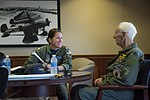 "Retired Cmdr. Dean ""Diz"" Laird, right, and Lt. Cmdr. Nicole Johnson conduct a flight brief for a T-34C Turbomentor (28171533846).jpg"
