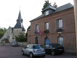 The church and town hall in Reux