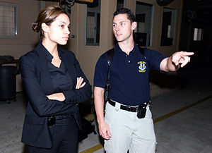 Eagle Eye - Rosario Dawson receiving a safety briefing from Special Agent Patrick McGee while researching her role as an AFOSI agent.