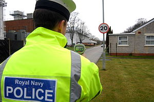 Royal Navy Police - A member of the Royal Navy Police carrying out a vehicle speed check at HMS Sultan in Gosport, Hampshire.
