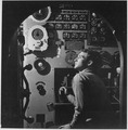 Sailor at work in the electric engine control room of USS BATFISH on war patrol. - NARA - 520856.tif