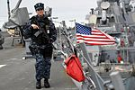 Sailor stands topside rover watch aboard USS Porter while the ship is pierside at Naval Station Rota, Spain. (33157992971).jpg