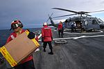 Sailors assigned to USS Porter unload supplies from an MH-60S Sea Hawk helicopter. (33795907106).jpg