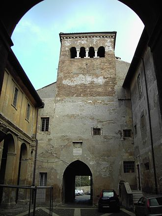 Santi Quattro Coronati - First courtyard with the guard tower.