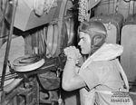Sergeant Reen of 2 Squadron RAAF checks his gun Hughes Mar 1943 AWM NWA0195.jpg