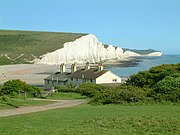 Seven Sisters cliffs and the coastguard cottages, from Seaford Head showing Cuckmere Haven (looking east - 2003-05-26)