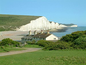 South Downs National Park - The Seven Sisters cliffs and the coastguard cottages, from Seaford Head across the River Cuckmere.