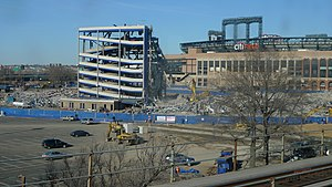 Shea Stadium - Demolition in progress. Top photo: close-up view of the stadium during demolition. Bottom photo: demolition as viewed from the IRT Flushing Line.