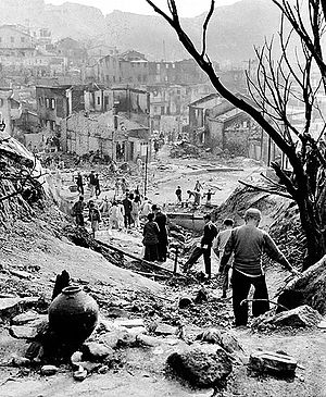 Ronald Holmes - The slum area in Shek Kip Mei after the great fire on the Christmas Day of 1953.