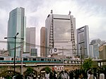 Shiodome skyscrapers viewed from Shimbashi Station Steam-Locomotive Square (2010-05-08 16.54.17).jpg