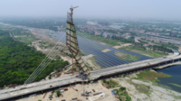 Signature Bridge on Yamuna river, during its construction