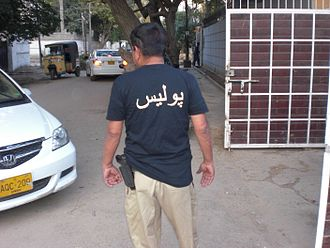 Law enforcement in Pakistan - A constable of the Sindh Police in uniform with a handgun on his belt.