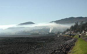 Inversion (meteorology) - Smoke rising in Lochcarron, Scotland, is stopped by an overlying layer of warmer air (2006).