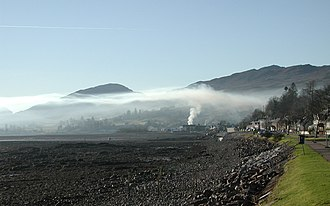 Nuclear winter - Smoke rising in Lochcarron, Scotland, is stopped by an overlying natural low-level inversion layer of warmer air (2006).